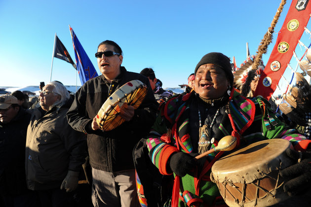 """People celebrate in Oceti Sakowin camp as """"water protectors"""" continue to demonstrate against plans to pass the Dakota Access pipeline near the Standing Rock Indian Reservation, near Cannon Ball, North Dakota, U.S. December 4, 2016. REUTERS/Stephanie Keith"""